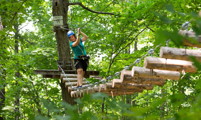 Person tree top trekking
