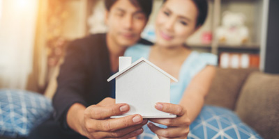 Young Couple with Home Insurance
